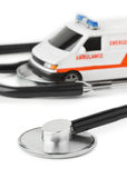 Stethoscope and toy ambulance car Stock Photos