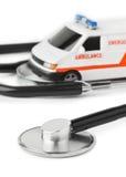 Stethoscope and toy ambulance car Stock Photos