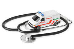 Stethoscope and toy ambulance car Royalty Free Stock Photos