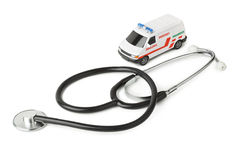Stethoscope and toy ambulance car Stock Image