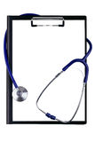 Stethoscope twisting around pad Royalty Free Stock Photos