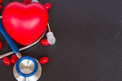 Stethoscope with two red hearts and pills Royalty Free Stock Image