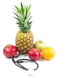 Stethoscope and various fruit Royalty Free Stock Photos