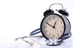 Stethoscope and vintage clock face simulating medical appointment for health concept royalty free stock photo