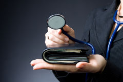 Stethoscope on wallet Stock Photos
