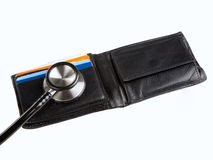 Stethoscope-wallet-2. Financial health check: Stethoscope on credit cards inside a  wallet Royalty Free Stock Images