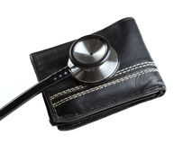 Stethoscope-wallet-3. Financial health check: Stethoscope resting on a  wallet Stock Image