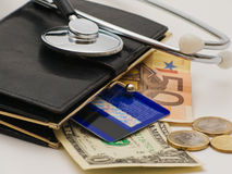Stethoscope and wallet Stock Image