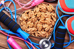 Stethoscope, walnuts, snickers, jump rope. Stock Image