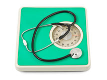 Stethoscope on weight scale Stock Photography