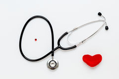 Stethoscope on white background with plush heart top view Royalty Free Stock Photo