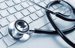 Stethoscope on a white laptop Stock Image