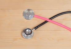 Stethoscope on wood Stock Images