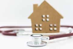 Stethoscope and wooden house. Image use for health medical care of family concept royalty free stock images