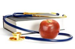 Stethoskop, Buch und Apfel Lizenzfreies Stockbild