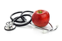 Stethoskop mit Apfel Stockfotos