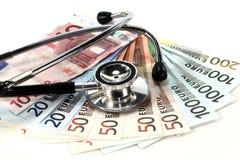 Stethoskop und Geld Stockfotografie