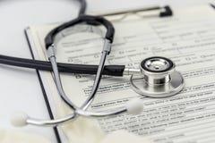 Stethoskop und weißer Handschuh des Latex Lizenzfreies Stockbild