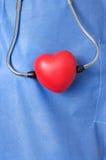 Stetoscopio con forma rossa del cuore Fotografia Stock
