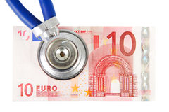 Stetoscopio con la banconota Fotografia Stock