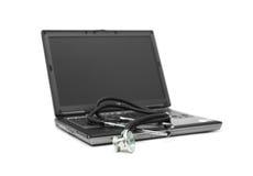 Stetoscopio e computer portatile Fotografie Stock Libere da Diritti