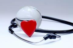 Stetoscopio e globo Immagini Stock Libere da Diritti