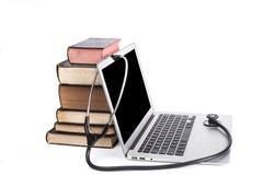 Stetoscopio e libri neri Fotografie Stock