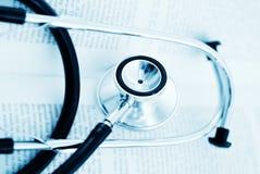 Stetoscopio e libro Fotografia Stock