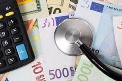 Stetoscopio e soldi Fotografia Stock