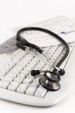 Stetoscopio e tastiera Immagine Stock