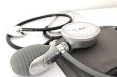 Stetoscopio e tensionamento Immagini Stock