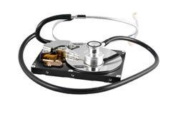 Stetoscopio isolato sul drive del hard disk Fotografia Stock