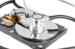 Stetoscopio isolato sul drive del hard disk Immagine Stock Libera da Diritti