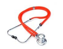 Stetoscopio rosso isolato su priorità bassa bianca fotografie stock libere da diritti