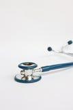 Stetoscopio su priorità bassa bianca Immagini Stock