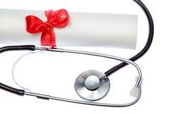Stetoscopio su priorità bassa del certificato. Fotografie Stock