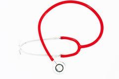 Stetoscopio su una priorità bassa bianca Fotografia Stock
