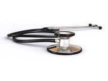 Stetoscopio sulla superficie di bianco Immagini Stock