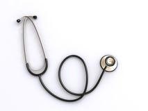 Stetoscopio sulla superficie di bianco Fotografie Stock
