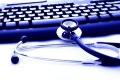 stetoskop för datortangentbord royaltyfria foton