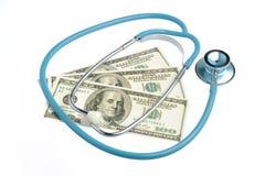 Stetoskop i pieniądze odizolowywający na bielu Obraz Royalty Free