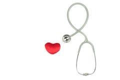 Stetoskop och röd härd Arkivfoto