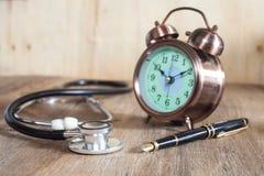 Stetoskop och springbrunn Arkivfoto