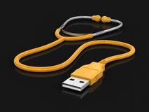 Stetoskop och USB kabel Arkivbild