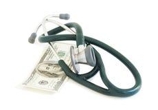 Stetoskop på pengar Royaltyfri Foto