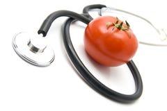 Stetoskop y tomate Imágenes de archivo libres de regalías