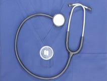 Stetoskopet skurar Pills Arkivfoto