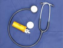 Stetoskopet skurar Pillspengar Royaltyfri Foto