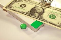Stetoskopu dolar, wydatek na zdrowie lub pomoc finansowa, fotografia stock