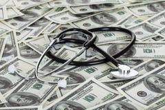 Stetoskopu i amerykanina dolary Obrazy Royalty Free
